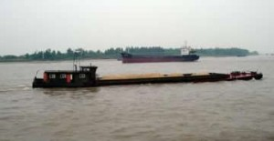 One of the many Yangtze River barges that inspired Dark Waters