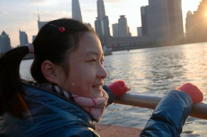 -Jingjing enjoys a moment of freedom traveling on the barge working boat BRIGHT WATER