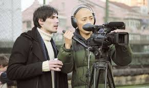 Gianpaolo Lupori (l.) on a commercial set with his Chinese crew